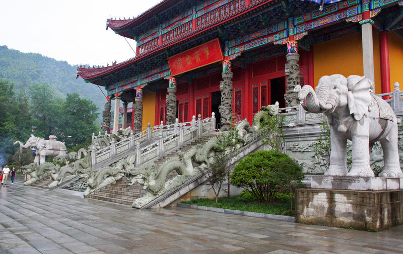 Entrance to a buddhist temple in Jiuhuashan, china. Entrance to a buddhist temple in Jiuhuashan, decorated with stone dragon and elephant statues, china royalty free stock photos