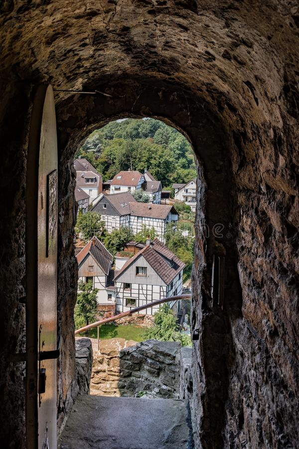 Entrance to a castlewith steel door and outlook on the city stock photo