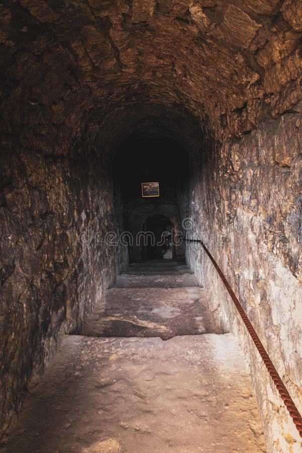 Entrance to the cave. Entrance with stairs in a church that lies between a cave, Old Orhei, Moldova stock photo