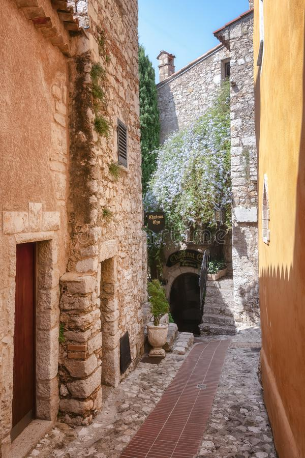 The entrance to the Chateau Eza restaurant in a narrow street in the old center of the  picturesque medieval village of Eze stock photos