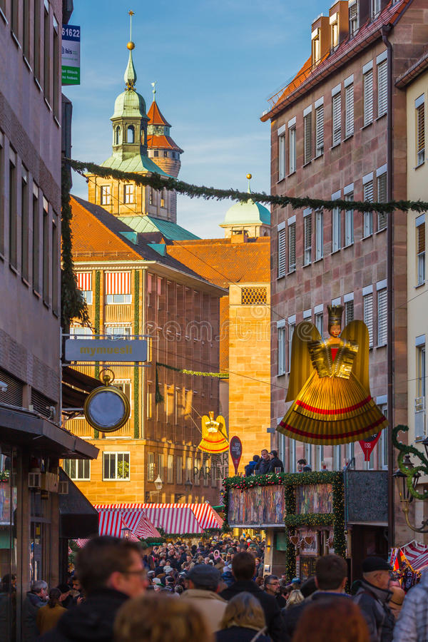 Entrance to Christmas Market -Christkind Angel-symbol Nuremberg-Germany. Christkind Angel- golden statue of angel hangs over entrance to main market. People royalty free stock photo
