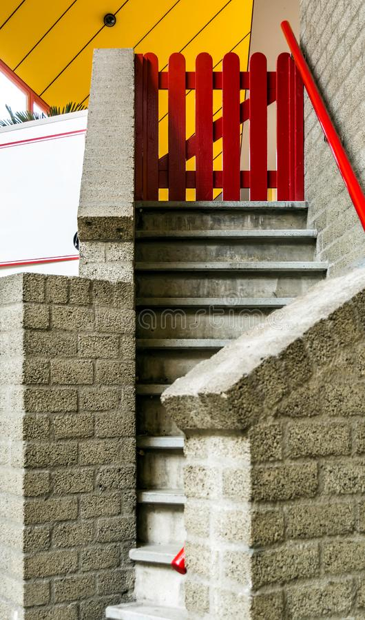 Entrance to the Cube house with stairs and small red gate royalty free stock images