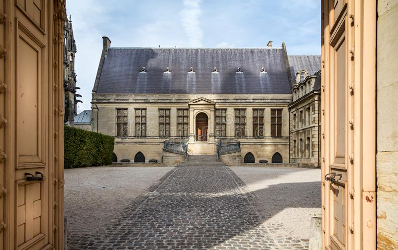 Entrance to famous archiepiscopal Palace of Tau in Reims, France stock image