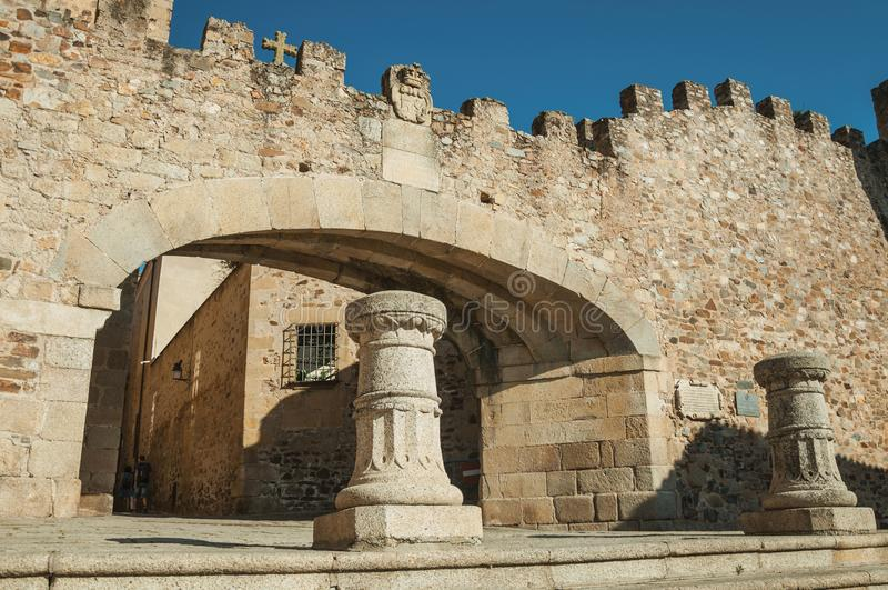 Entrance to the historical city center on a stone wall at Caceres royalty free stock image