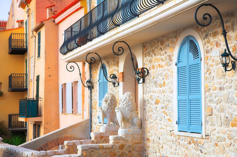 Entrance to the house in Antibes France. Pretty stone house with blue wooden shutters and stone walls stock photography