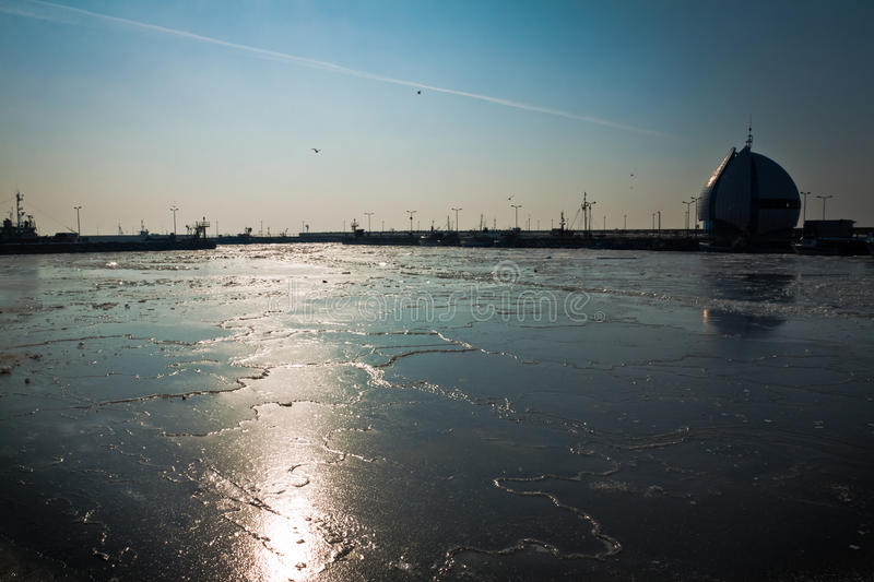 Entrance to ice bound harbour royalty free stock photos