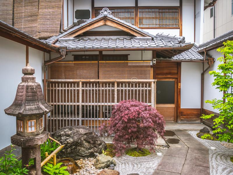 An entrance to a japanese traditional hotel. Sliding doors at a ryokan in Japan. A yard of a traditional japanese house in Kyoto royalty free stock image