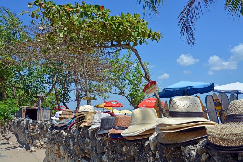 Entrance to Legian Beach including Sun Umbrellas and Hats. stock image
