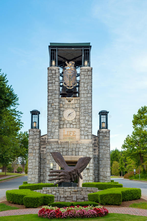 Entrance to Life University in Marietta, GA. MARIETTA, GA - AUG 2, 2014: Bell tower at entrance to Life University, a school that specializes in chiropractic and stock images