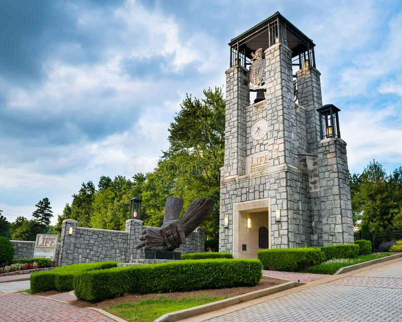 Entrance to Life University in Marietta, GA. MARIETTA, GA - AUG 2, 2014: Bell tower at entrance to Life University, a school that specializes in chiropractic and stock photo