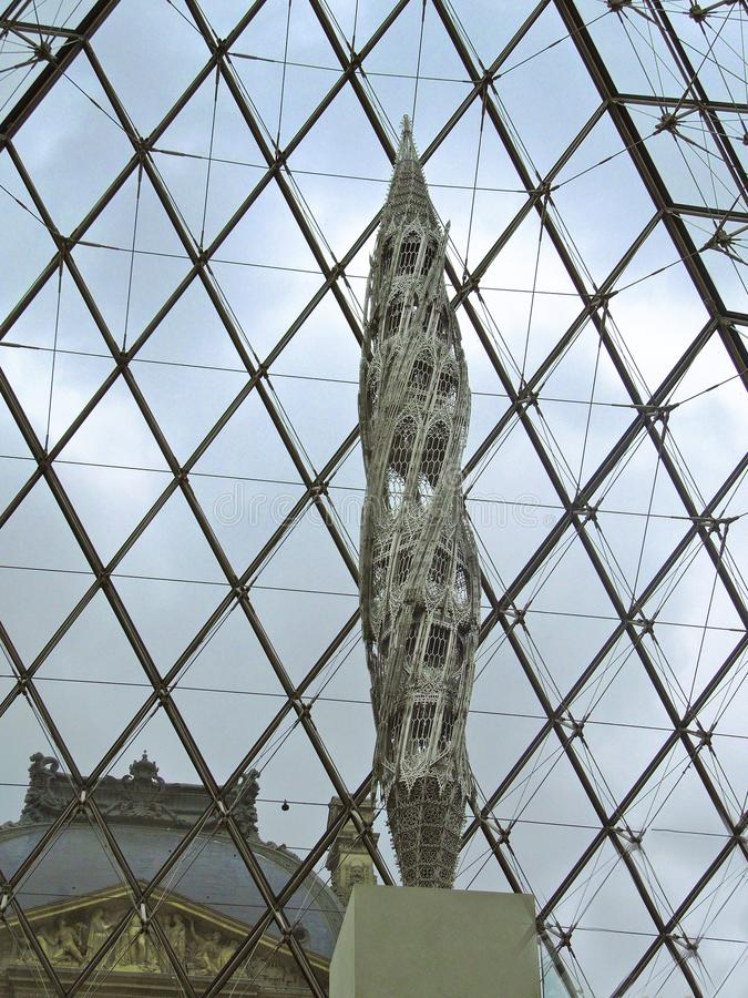 Louvre Pyramid Interior with Sculpture royalty free stock photography
