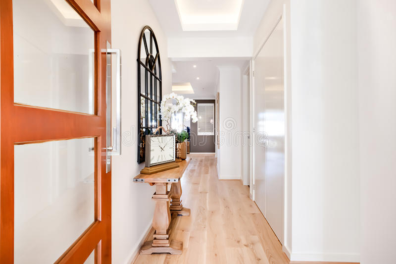 Entrance to a luxury house through the hallway including furniture stock image