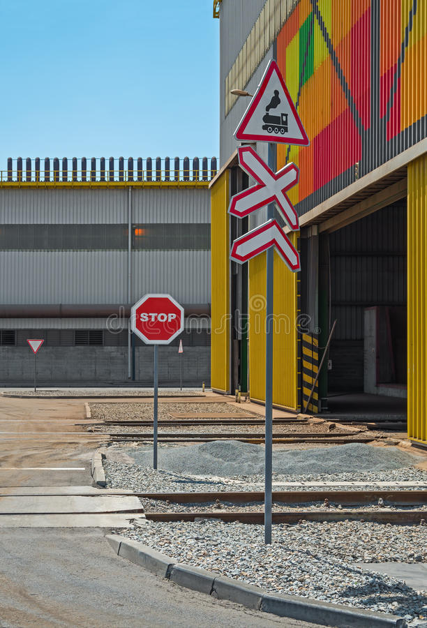 Entrance to manufacture. Railroad crossing entering the metallurgical electro furnace plant royalty free stock photo
