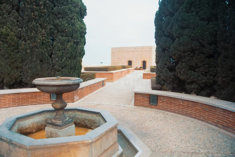 Entrance to medieval moorish fortress Alcazaba in Almeria, gardens and trees and a fountain, Almeria, Andalusia, Spain stock images