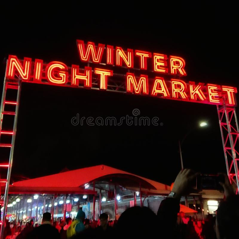 Entrance to Melbourne's Queen Victoria Winter Night Market. Held weekly during winter, the busy night market has food, drinks, and music stock images