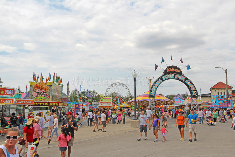 Entrance to the Midway at the Indiana State Fair. Fairgoers at the main entrance to the Midway of the Indiana State Fair on August 12, 2012. This very popular royalty free stock images