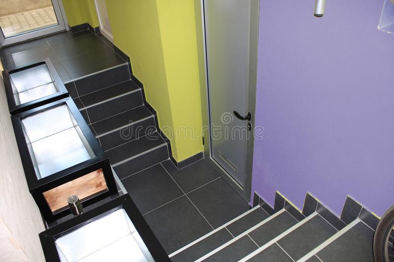Entrance to the modern colored basement royalty free stock photography