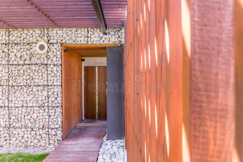 Entrance to a modern stone house royalty free stock photo
