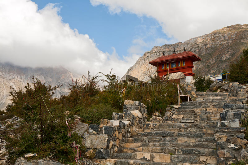 Entrance to Muktinath temple. Long staircase to the entrance of Muktinath temple stock photos