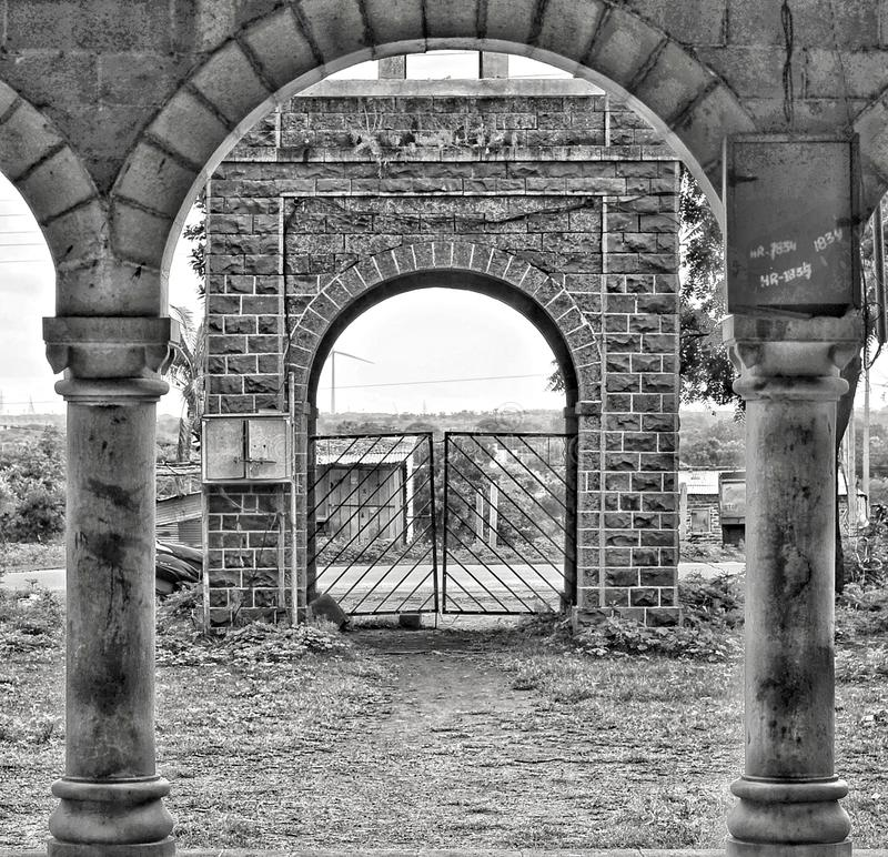 The entrance to old temple. Arch, curve, pillar, gate, histrical, accient, india, cannon, frame, frameinframe, amazing, symetrical, wonderful, tourost, tourism royalty free stock photos