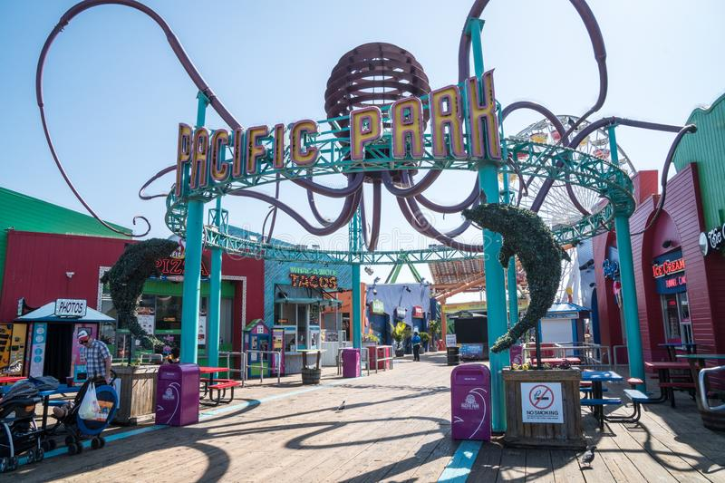 Entrance to Pacific Park amusement park at the Santa Monica Pier in Southern California on a sunny day stock photos