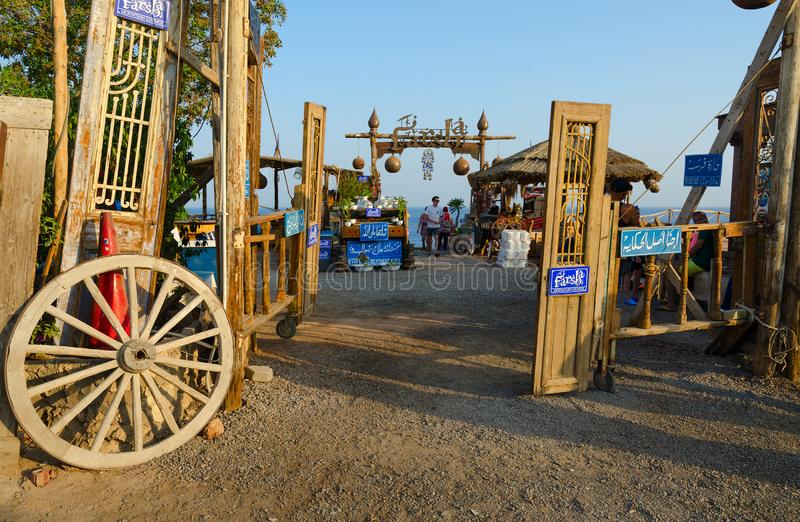 Entrance to popular Cafe Farsha with original design in Hadaba district, Sharm El Sheikh, Egypt. SHARM EL SHEIKH, EGYPT - SEPTEMBER 19, 2019: Unknown people stock photos
