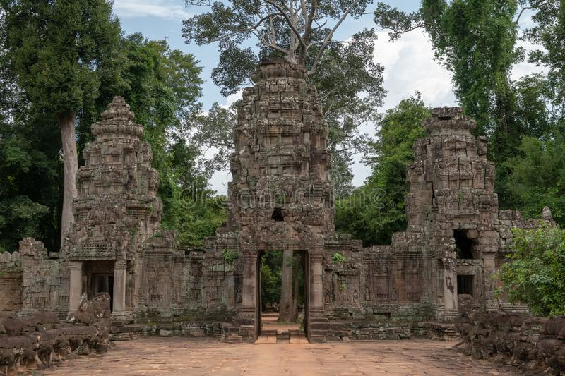 Entrance to Preah Khan with three towers stock image