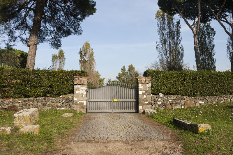 Entrance to a private villa on the Via Appia Antica, Rome. Italy. The gate with flower beds of an old mansion on the Via Appia Antica in Rome. Italy. Some stock photo