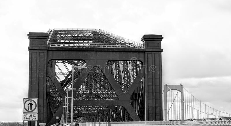 Entrance to the Quebec Bridge. Circulation of metal structures Canada stock photos