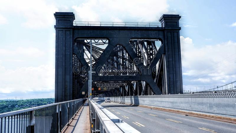 Entrance to the Quebec Bridge. Circulation of metal structures Canada stock photo