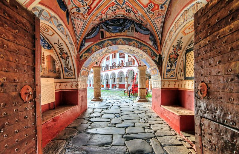 Entrance to the Rila monastery. Beautiful view of the entrance gate at the Orthodox Rila Monastery, a famous tourist attraction and cultural heritage monument in royalty free stock images