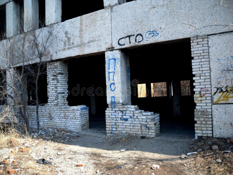 Entrance to the ruined school stock images