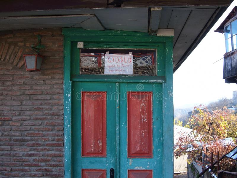 Entrance to a small tourist shop in a Georgian village in the mountains in November - closed until March. royalty free stock photos