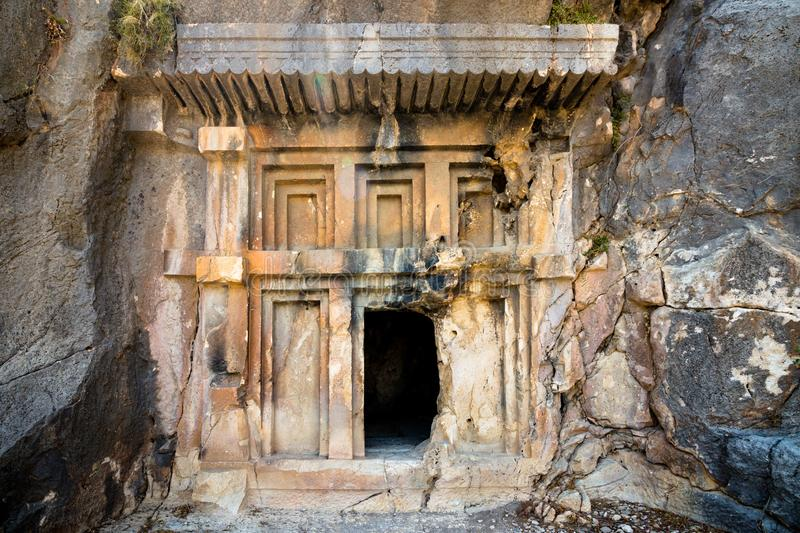 Entrance to the tomb of ancient civilization. Tombs are carved into the rocks on the territory of modern Turkey royalty free stock photo