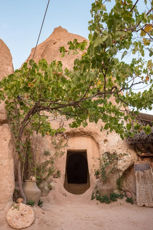 Entrance to the traditional cave house made in rock formations of Cappadocia, Turkey royalty free stock image