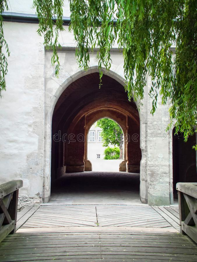 The entrance to the tunnel in front. Of the bridge. Arch in the old building. Beautiful alley in Gifhorn royalty free stock images