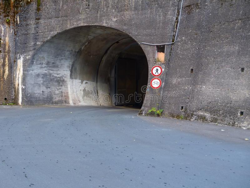Entrance to a tunnel with no pedestrians allowed. An entrance to a tunnel with no pedestrians allowed stock photo