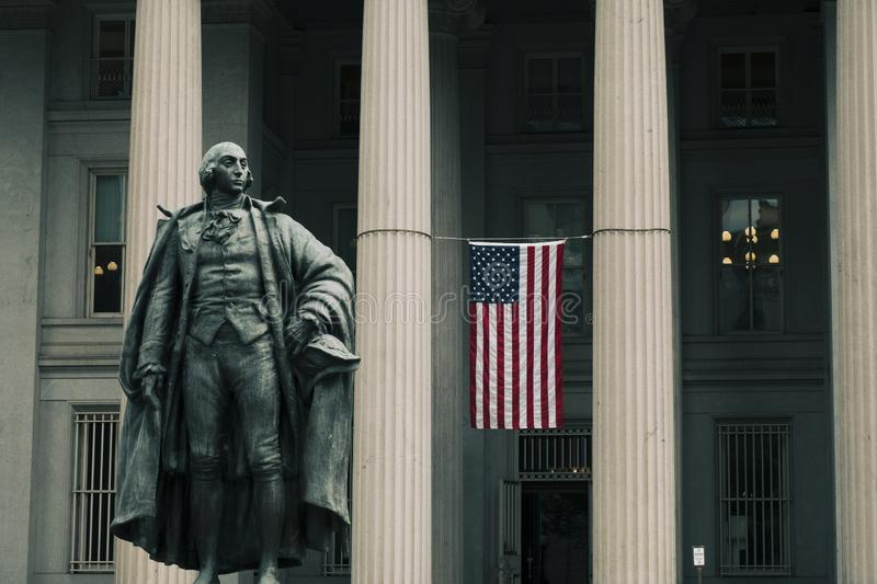 Entrance to the United States Treasury Building. Washington DC, June 2017, United States: Albert Gallatin statue in front of the northern entrance to the United stock photos
