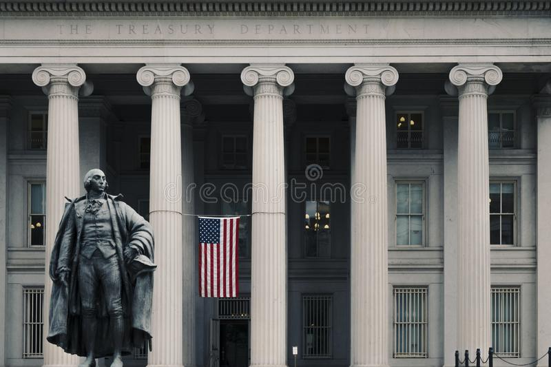 Entrance to the United States Treasury Building. Washington DC, June 2017, United States: Albert Gallatin statue in front of the northern entrance to the United royalty free stock photography