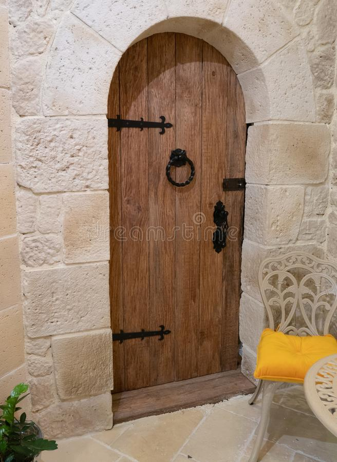 Entrance to vintage house with wooden door in mediterranean design and small chair stock photo