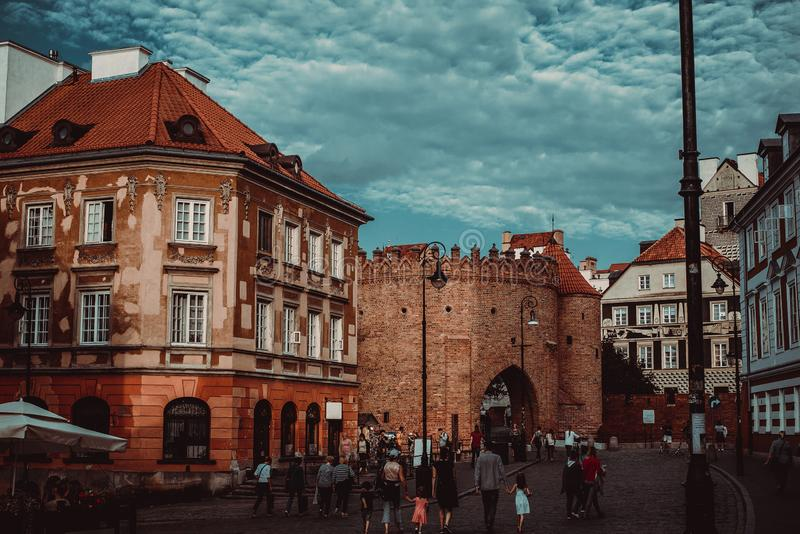 Entrance to Warsaw city Barbican, houses Old and New Town. Travel to Poland. Tourism explore concept. Polish architecture. City. Tour. Urban landscape. Street stock photography