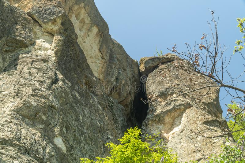 The entrance to the The womb cave also known as Utroba cave in Bulgaria stock photography