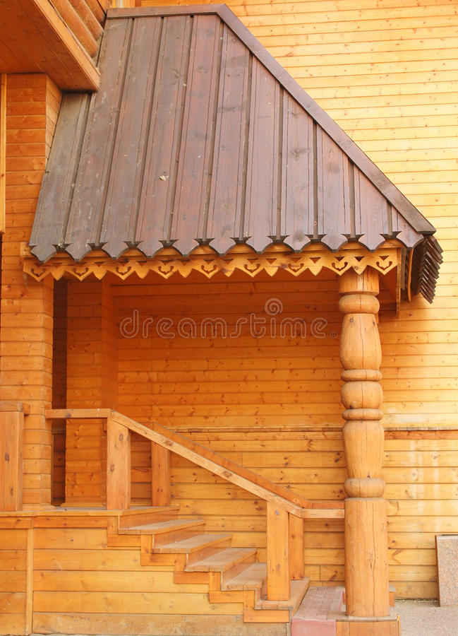 Entrance to the wooden house stock photos