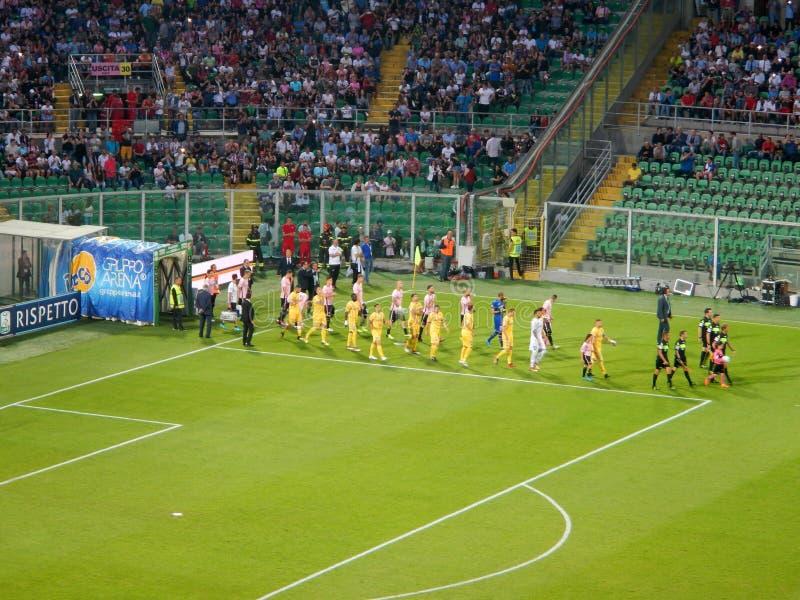 PALERMO, ITALIA - June 13, 2018 - US Città di Palermo vs Frosinone Calcio - Serie B 2017-2018 Playoff Final. The entrance of the two teams in the playground stock photography