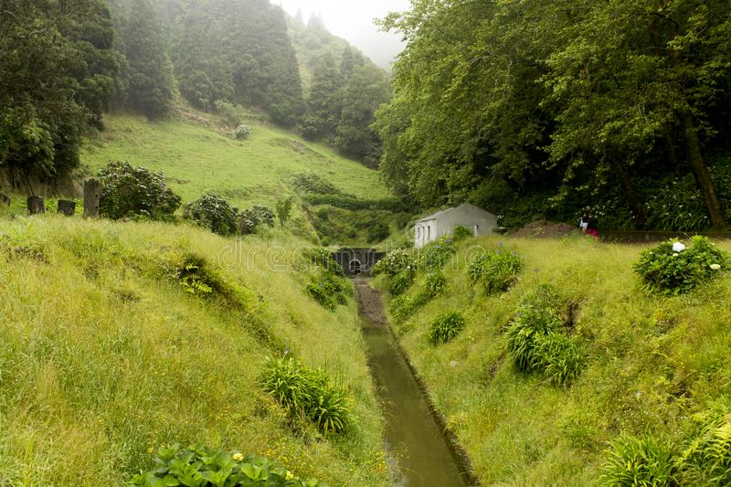 Entrance of an underearth canal in the Sete Cidades Caldera in the Sao Miguel Island, Azores. stock photography