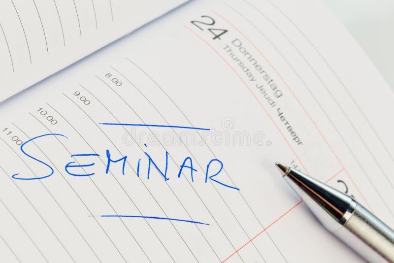 Entrata nel calendario: seminario immagini stock