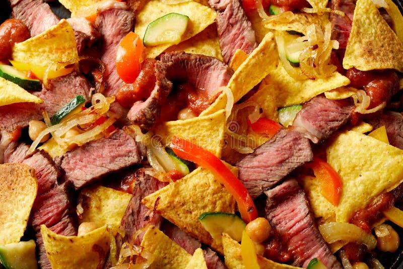 Entrecote da carne e receita de Tex-Mex dos nachos fotografia de stock