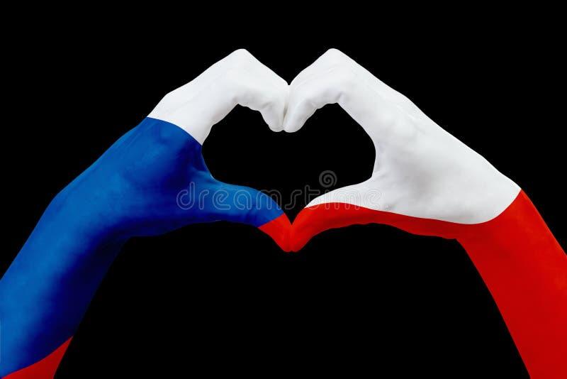 Entrega a bandeira da república checa, dão forma a um coração Conceito do símbolo do país, isolado no preto ilustração stock