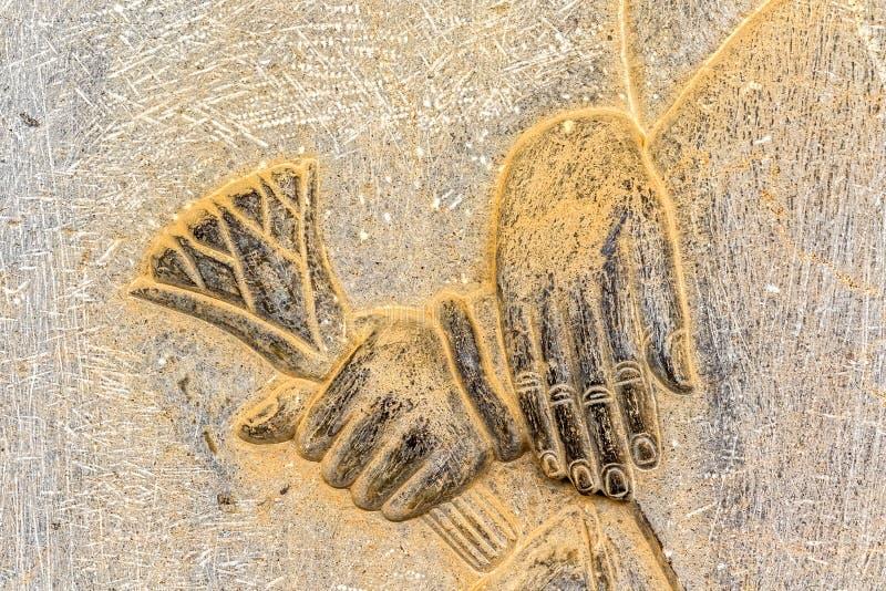 Entrega o detalhe Persepolis do relevo foto de stock royalty free