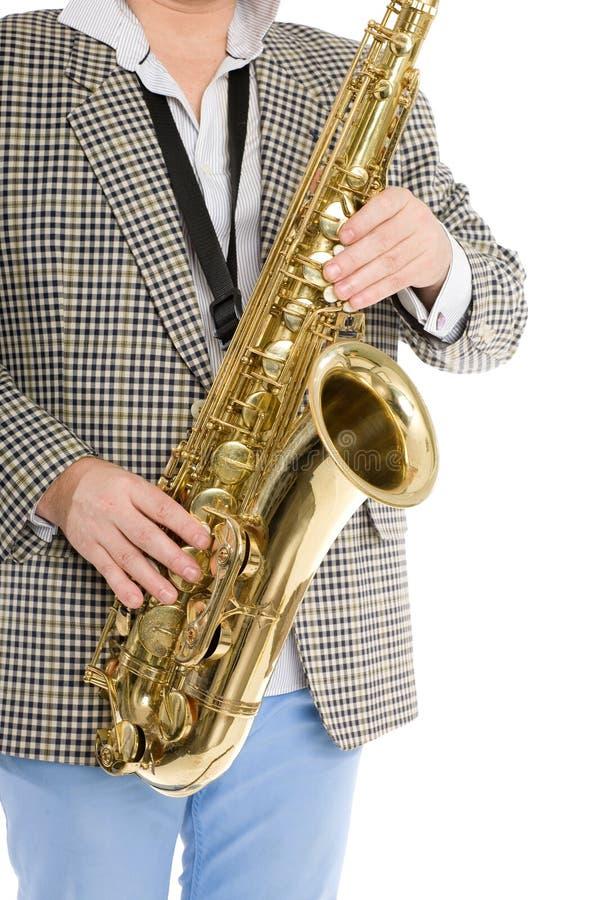 Entrega o músico que joga o saxofone fotos de stock royalty free